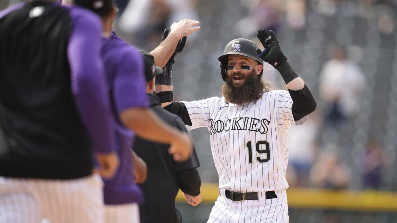 Blackmon, Rockies pass brooms to Padres
