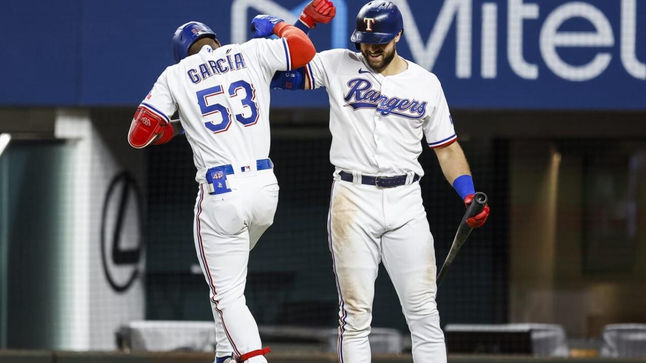 Garcia drives Rangers with 2 home runs