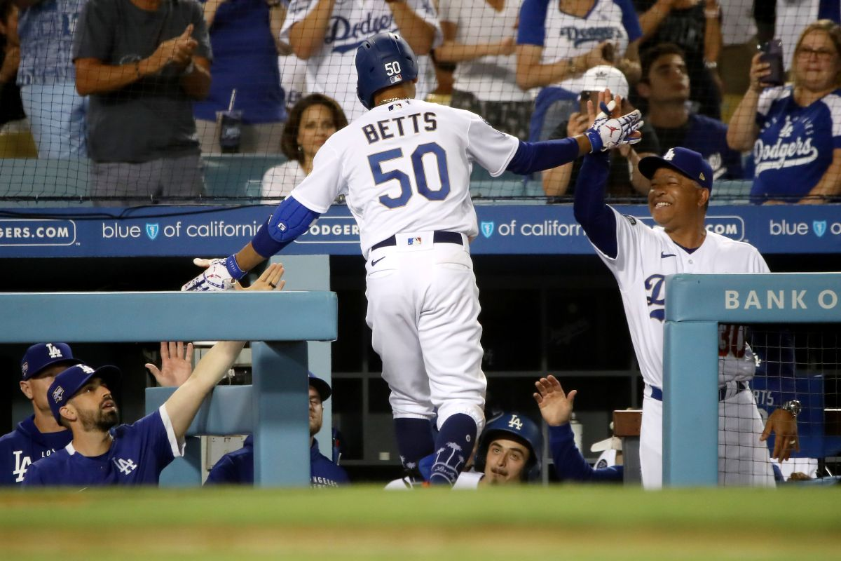 More than 52,000 people showed up Tuesday to support the Dodgers, with one of them making the big catch of the game.