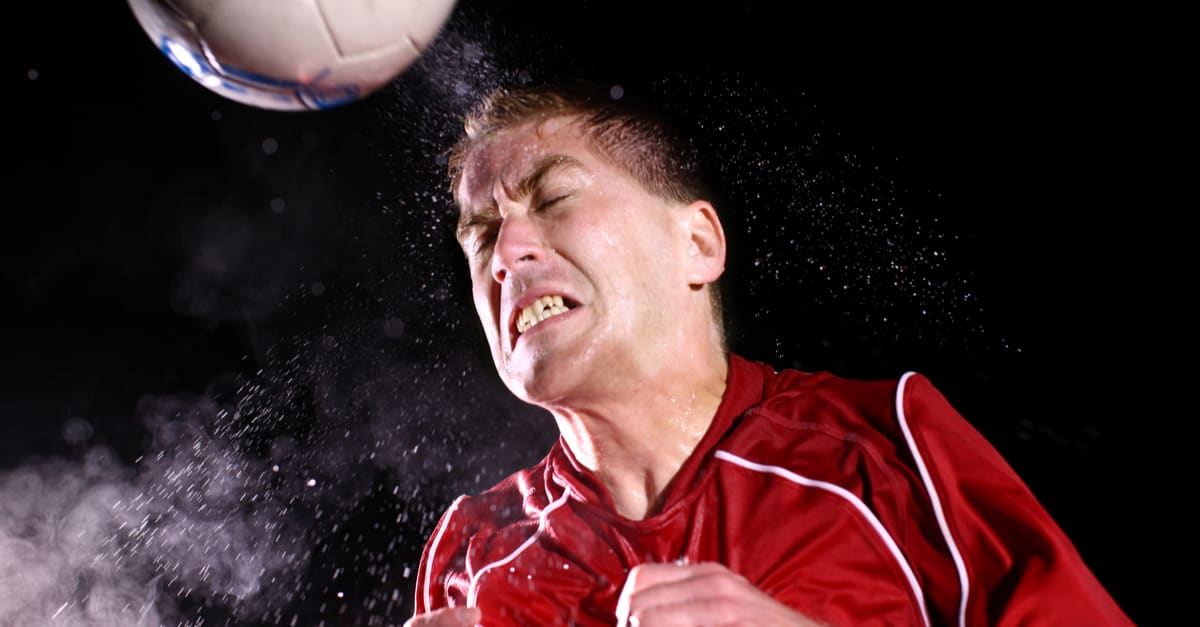 heading Soccer player hitting ball with head