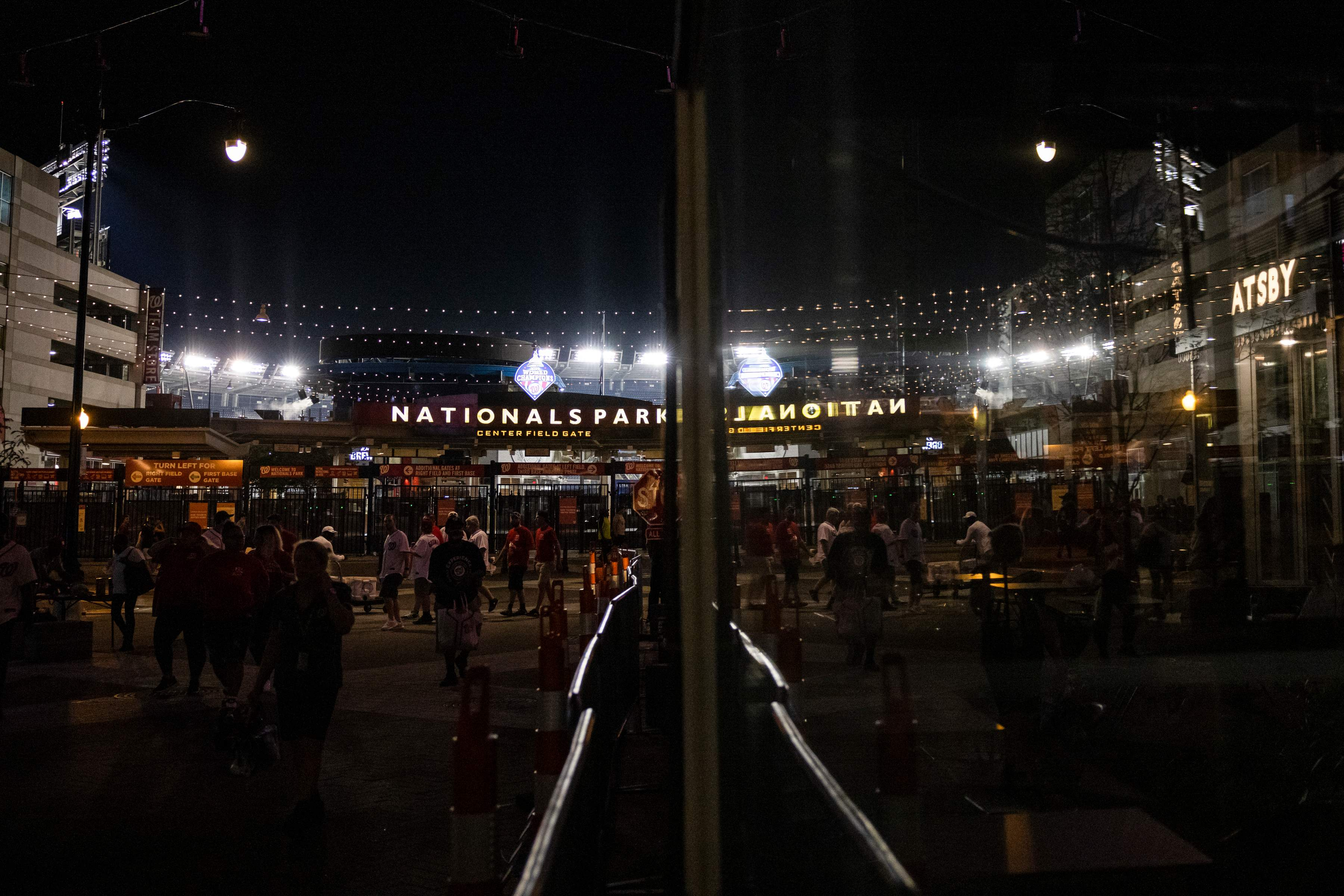 Fans leave Nationals Park after a shootout outside the Third Base Gate during the game on July 17, 2021 in Washington, DC.