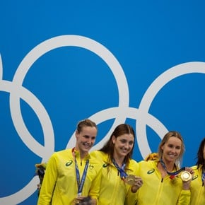 Australia won gold in the 4x100 relay, with a new world record