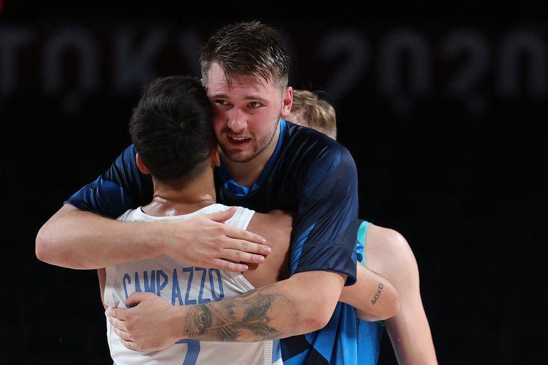 Slovenian Luka Doncic (right) hugs Argentina's Facundo Campazzo after the Group C men's preliminary round basketball match between Argentina and Slovenia during the Tokyo 2020 Olympic Games at Saitama Super Arena in Saitama on July 26, 2021