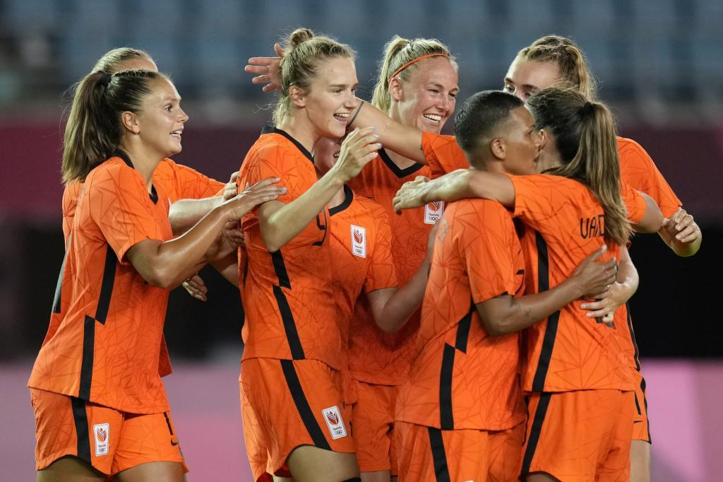 The Netherlands players celebrate a goal in the Olympic tournament.