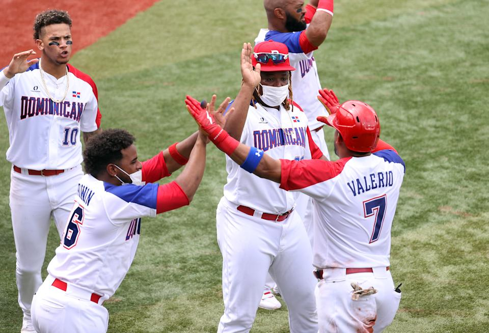 YOKOHAMA, JAPAN - JULY 30: Charlie Valerio # 7 of Team Dominican Republic celebrates with teammates after scoring in the fifth inning against Team Dominican Republic during the baseball opening round Group A game on day seven of the Tokyo 2020 Olympic Games at Yokohama Baseball Stadium on July 30, 2021 in Yokohama, Kanagawa, Japan. (Photo by Koji Watanabe / Getty Images)