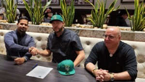 Cuban player signing contract who defected from pre-Olympic