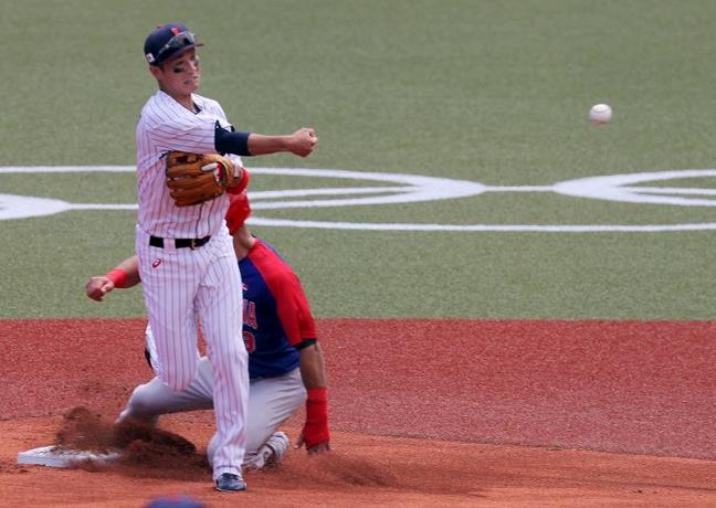 Japan scores three in the ninth and leaves the Dominican