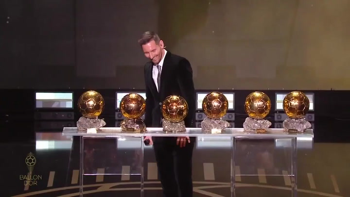 Messi poses with his six Ballon d'Or