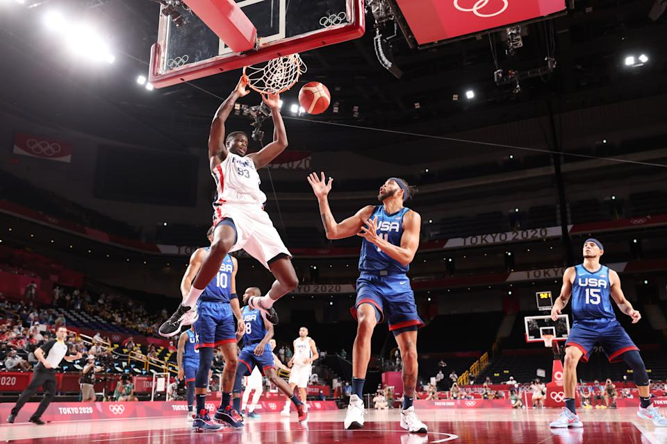 SAITAMA, JAPAN - JULY 25: Moustapha Fall # 93 of Team France dunks the ball over JaVale McGee # 11 of Team United States during the second half of the Men & # 39; s Preliminary Round Group B game on day two of the Tokyo 2020 Olympic Games at Saitama Super Arena on July 25, 2021 in Saitama, Japan. (Photo by Gregory Shamus / Getty Images)