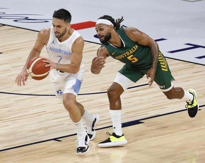 Facundo Campazzo and Patty Mills. Ethan Miller / Getty Images / AFP