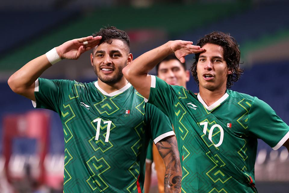SAITAMA, JAPAN - AUGUST 06: Alexis Vega # 11 of Team Mexico celebrates with Diego Lainez # 10 after scoring their side & # 39; s third goal during the Men & # 39; s Bronze Medal Match between Mexico and Japan on day fourteen of the Tokyo 2020 Olympic Games at Saitama Stadium on August 06, 2021 in Saitama, Tokyo, Japan. (Photo by Leon Neal / Getty Images)