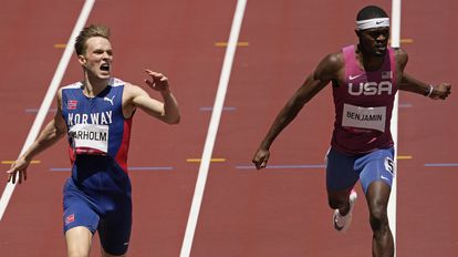 Rai Benjamin is second to Karsten Warholm, who set a new world record in the 400m hurdles final.