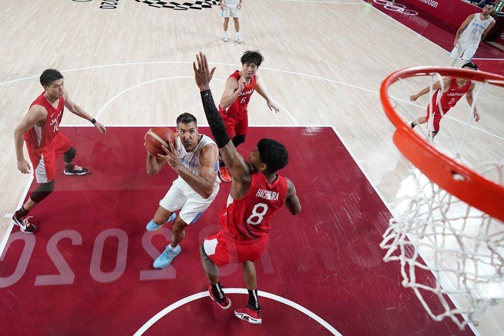 Scola, in action against Japan. (Photo by Charlie NEIBERGALL / POOL / AFP)